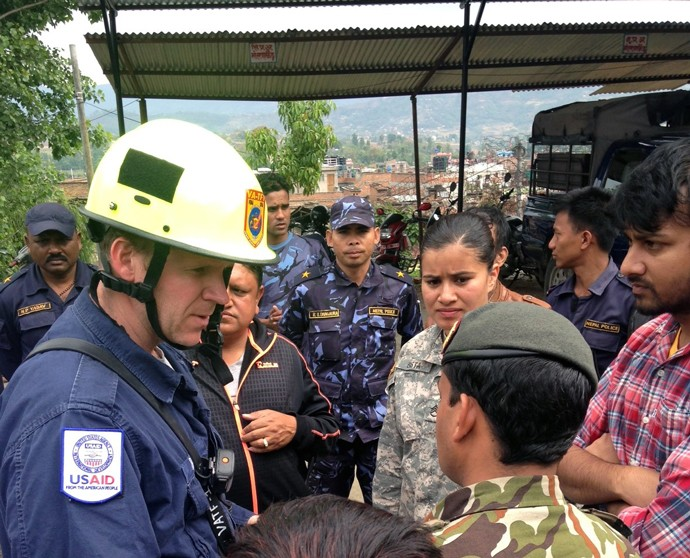 Mike Davis, a member of USAID's Disaster Assistance Response Team, speaks with the Nepalese Army and the community in Bhaktapur,