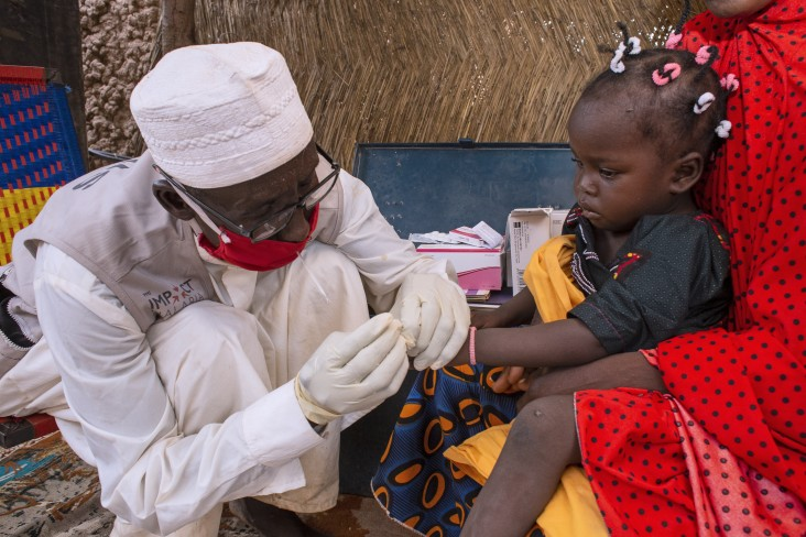 A child receives a rapid test for malaria