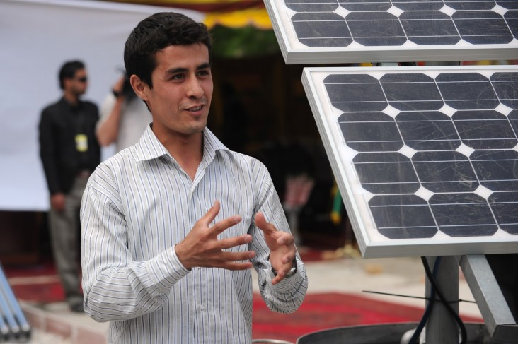 Ahmad Murtaza Ershad explains a solar power project during the dedication of the USAID-funded Kabul University Renewable Energy