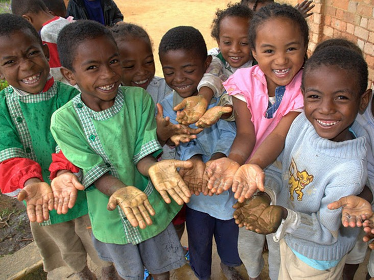 Children Proudly Show Their Lathered Hands Before Rinsing