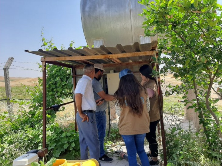 Engineers conduct assessments on farms' water pumps that will be powered through solar energy.