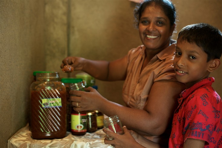 A mother and son make a chutney in Sri Lanka.