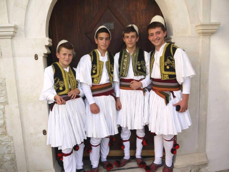 Young boys in the traditional folk costumes of Gjirokaster, a UNESCO World Heritage site, pose in this behind-the-scenes shot fr