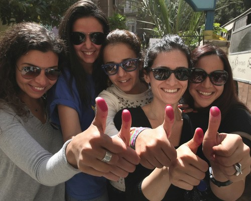 Egyptian women show their ink-stained thumbs after voting in Cairo, March 19, 2011.