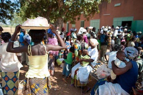 Children and young adults line up to receive MenAfriVac™ in the village of Koubri, Burkina Faso.