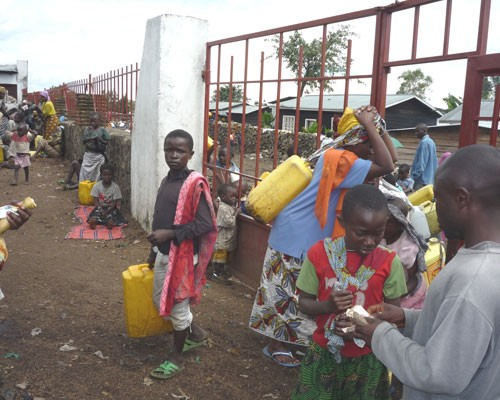 People buy water at an official sale point in Goma.