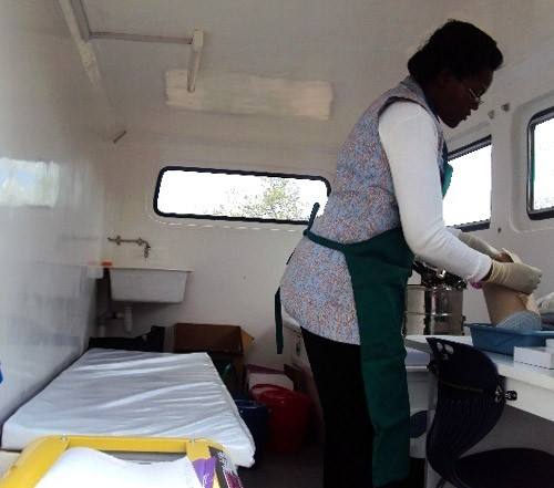 Dr. Ruth Jahonga prepares contraceptive implants inside the health wagon.