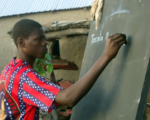 A young Malian practices basic literacy skills.