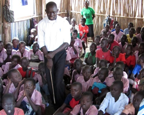 A teacher at Lighthouse International Primary School in Munuki Payam, Juba County, South Sudan, leads a lesson using South Sudan