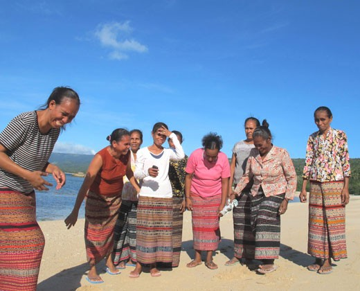 A women's group in Com supports turtle conservation activities. Robela da Cruz is pictured on far left.