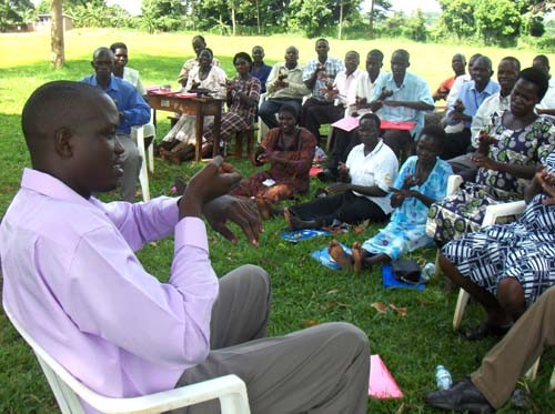 Teachers attend a session on basic skills in sign language at Buckely Primary School, Iganga, Uganda.