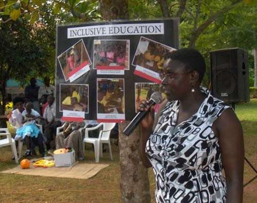 Jessica Ilomu, a USAID education specialist, addresses participants during a special needs education training session.