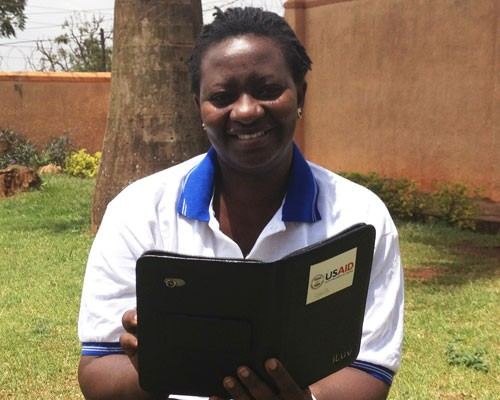 Christine Ninsiima wirelessly submits data collected with electronic tablets during trachoma mapping exercises.