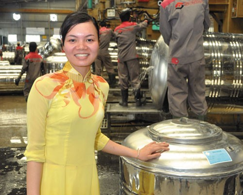 Dang Thi Phuong shows new water tanks at the Sonha factory in Hanoi.
