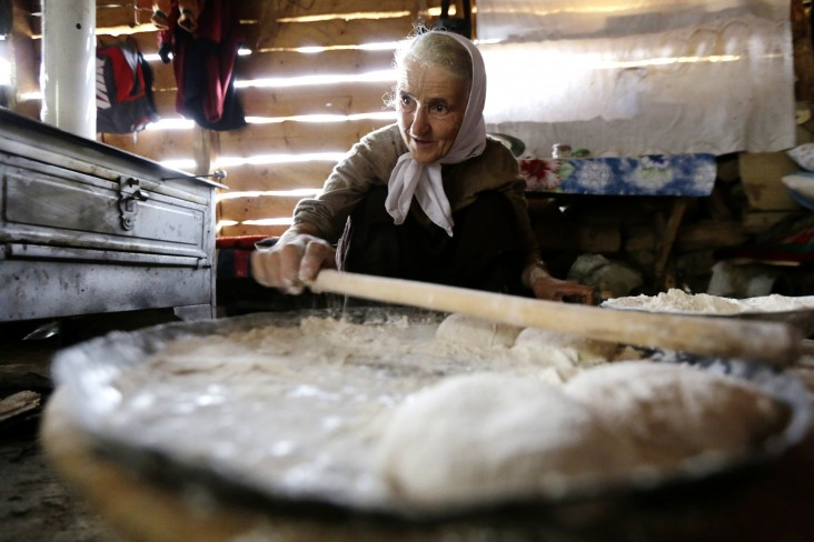 A woman in Bosnia and Herzegovina makes traditional bread.