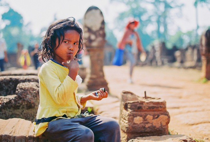 A child beggar in front of Banteay Srey Temple, Cambodia.