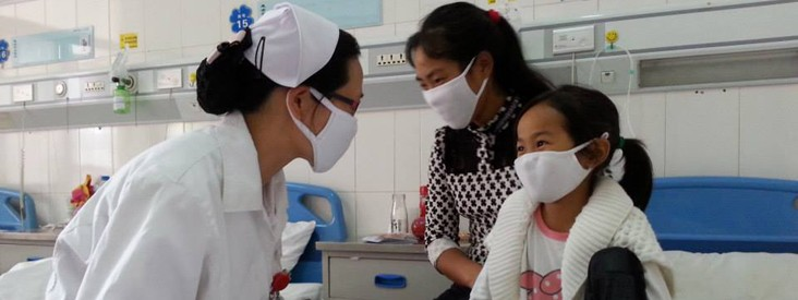 CAP-TB - A health worker speaks to a young girl and her mother