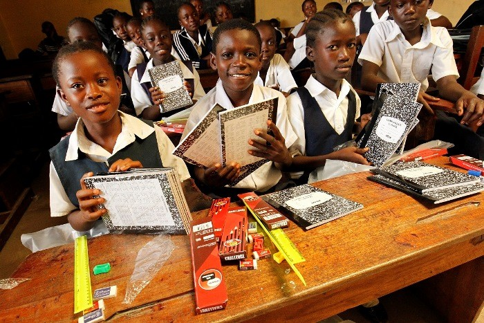 Students with USAID provided school supplies