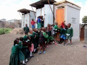 Children line up to use a Sanergy toilet