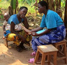 A Care Group volunteer conducts a home visit.