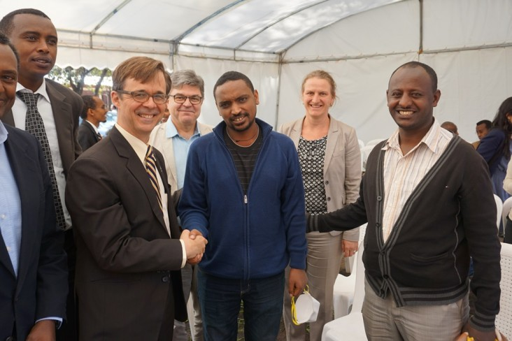 U.S. Deputy Chief of Mission Peter Vrooman greets former MDR-TB patients (now cured) of the USAID-supported ALERT hospital durin