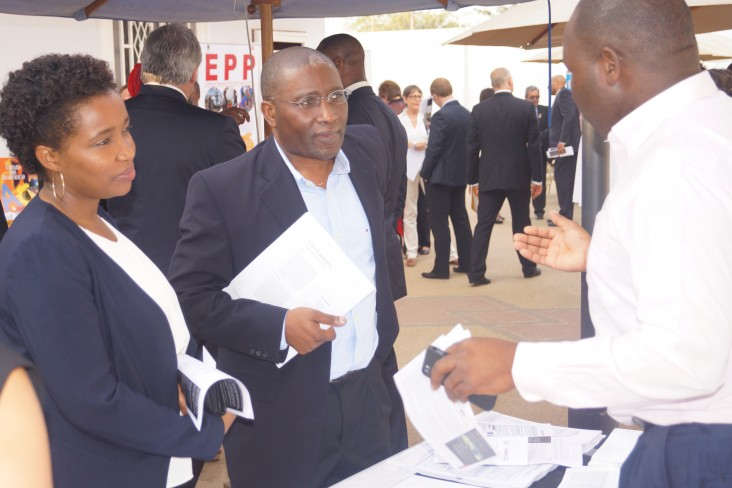 USAID implementer partner discusses potential activities with a private company representative.
