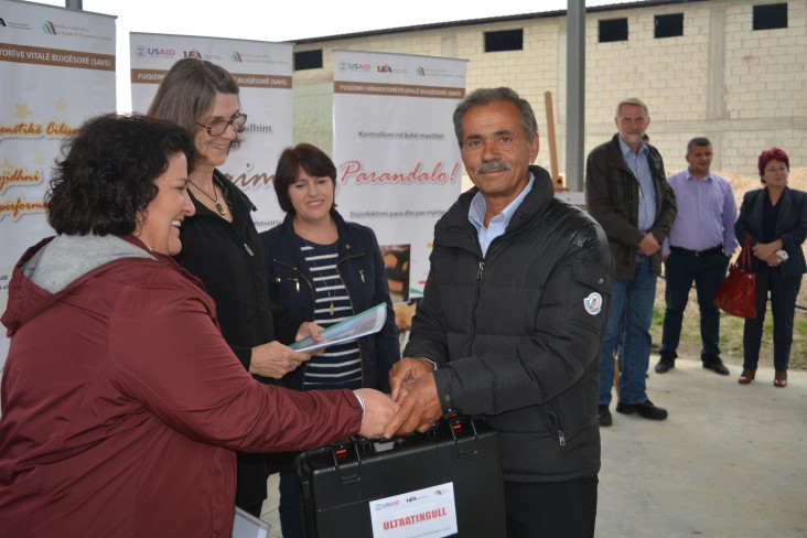 Man receives livestock equipment