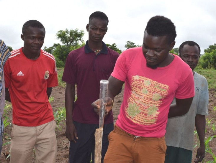USAID helps farmers access tools such as this rain gauge that will help them adapt to climate change.