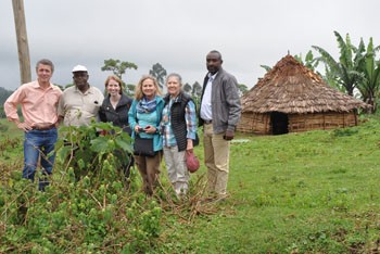 Dr. Andrew Umhau (left) and Whitney Ball (4th from left) meet with Metad and Renew members in the Ethiopian countryside.