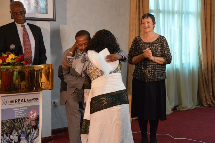 USAID official Jeanne Rideout watches as one of four Ethiopian mothers receive the 2014 REAL Awards.