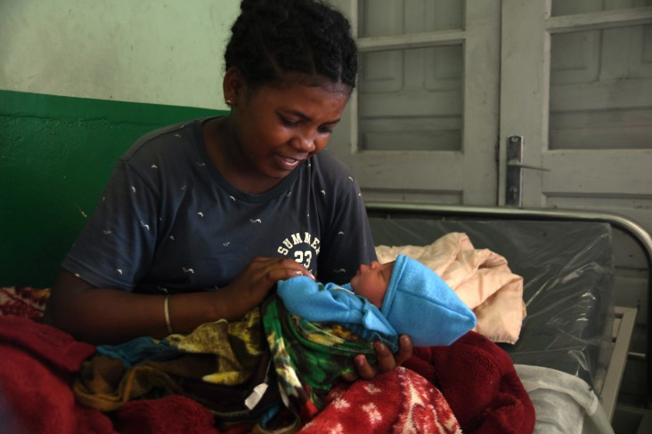 Marriboa, pictured with her two-day old son Pascal, receives counseling on breastfeeding after delivering at a USAID-supported facility in Madagascar.