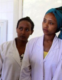 Midwife Kasech Negash, middle, and nurse Dinkineh Dawit, right, listen closely to Zergu Tafese, the USAID Integrated Family Heal
