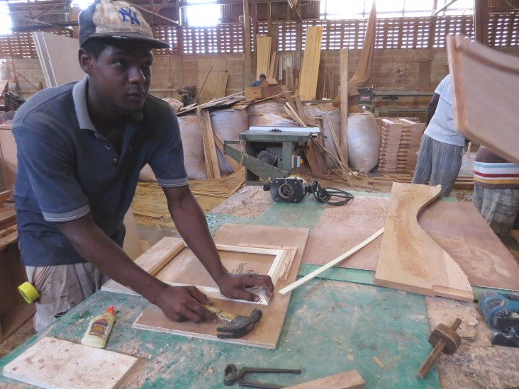 Byron Ettienne, 20, is hard at work learning the wood trade.