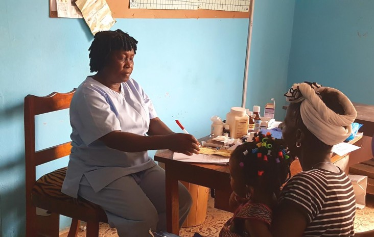 Elizabeth Coker (Nurse Betty) registers a patient at her maternal and child health post, Freetown, Sierra Leone.