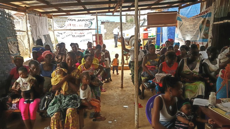 Women wait to be registered and see Nurse Betty and her staff at the maternal and child health post in the Malama suburb of Freetown, Sierra Leone.