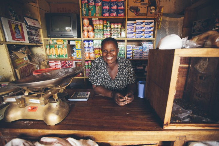 Maama Tina owns a shop in Kasekula, a town on Bugala Island, Uganda. As a result of the island's improved infrastructure,