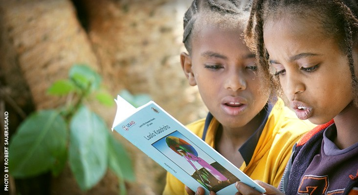 Image of Ethiopian girls reading a textbook