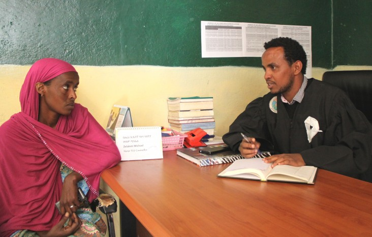 Zelalem Michael, right, gives legal assistance to Asha Adem at the Harar Legal Aid Center.