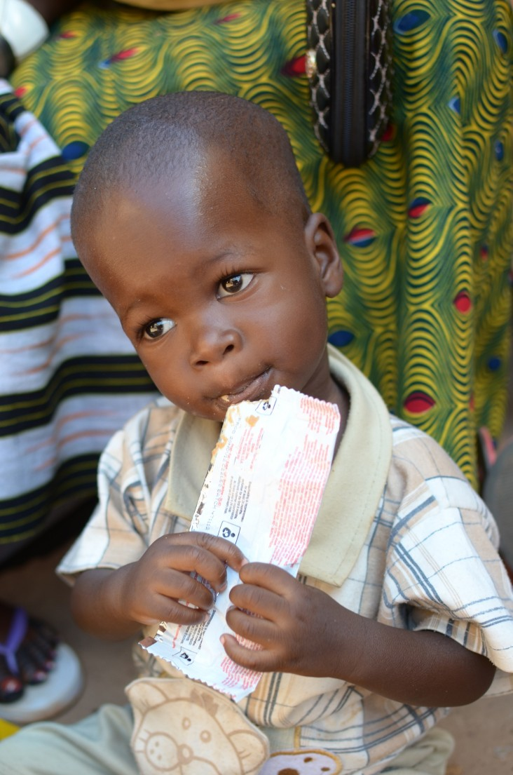 A child in Burkina Faso enjoys a ready-to-use supplementary food product.