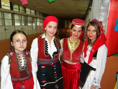 Students from the Zivko Brajkovski Primary School in Butel, Macedonia, wear traditional dress May 8, 2013, at ceremony celebrati
