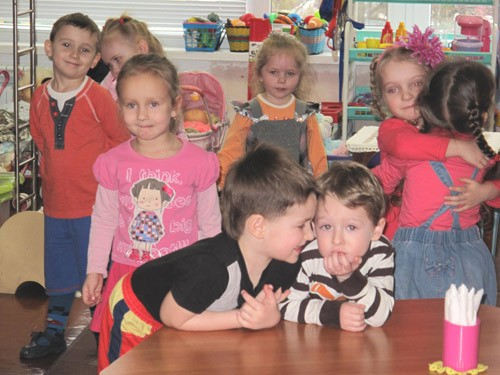 "For the 2- and 3-year-old children of ""Veselka"" group, the morning starts with warm hellos to each other."