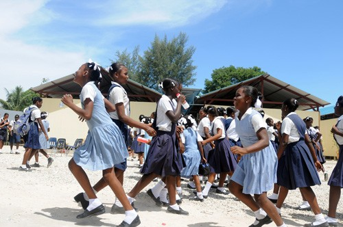 Schoolchildren run to recess at Ecole Marie Dominique Mazzarello in Port-au-Prince on June 18, 2010. The school's classrooms wer