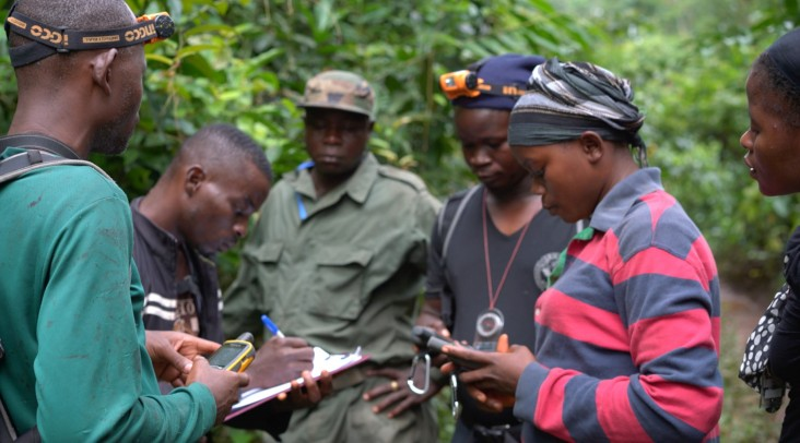 Community ecoguards, Felecia Kyne and Mathaline Garley, improve their GPS skills during their first field mission in Grebo-Krahn National Park in April 2018