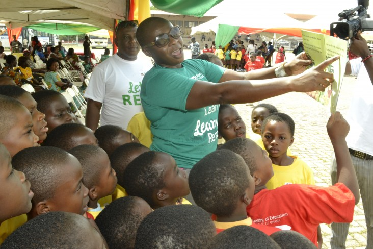 Janet Awokoya, a school report card specialist, interacts with children during the reading festival in Kumasi.