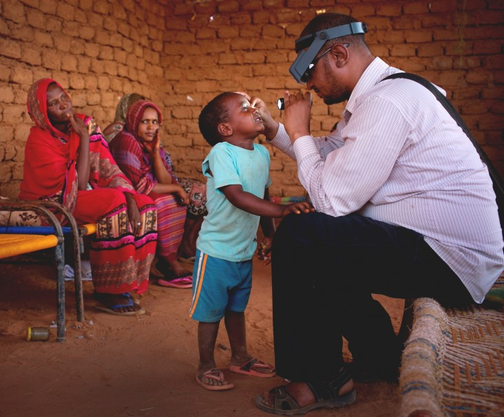 Anwar is examined by a doctor from Sightsavers.