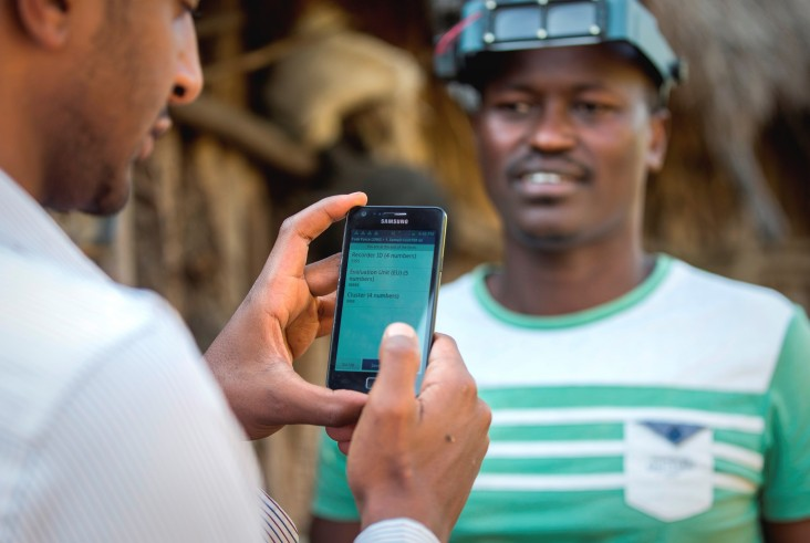 A member of the Global Trachoma Mapping Project team uses a smart phone to log data.