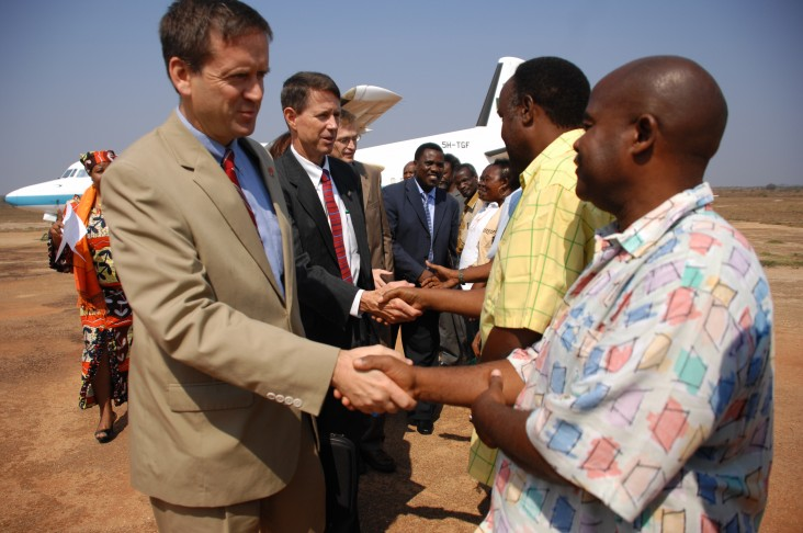 Ambassador Mark Green and Paul Monger, chief of staff for the Combined Joint Task Force-Horn of Africa, are greeted by Tanzania's ministers and staff after landing in Lindi in September 2008.
