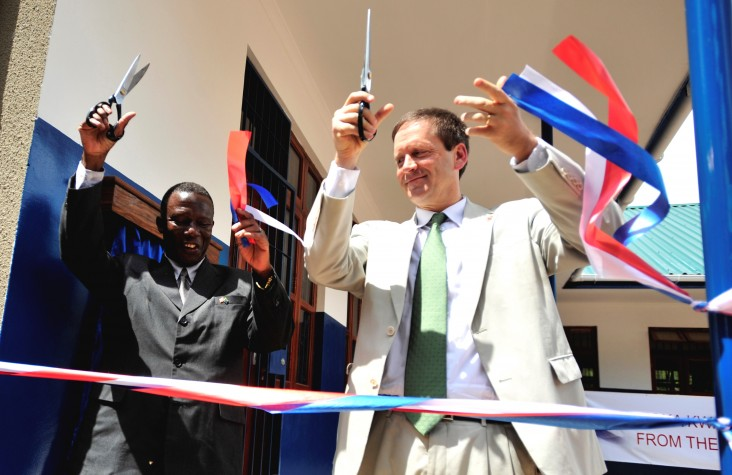 Ambassador Mark Green cuts a ribbon during a dedication ceremony at Jitegemee Secondary School in Dar es Salam, Tanzania.
