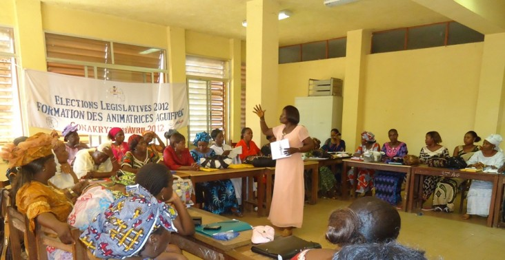 A woman leads a civic education class.