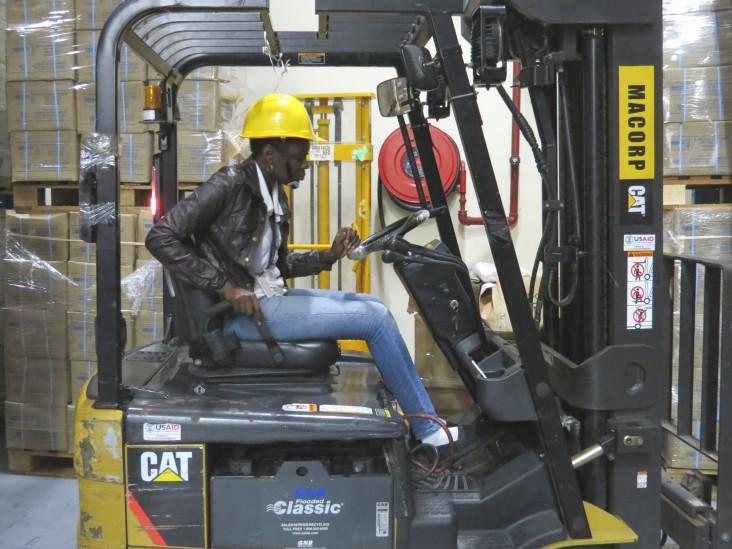 The facility's lone female forklift driver is at home in the male-dominated environment.